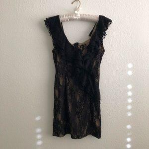 Dresses & Skirts - NikkiBikki black lace mini dress